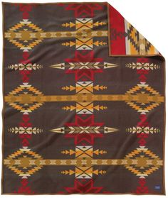 The Gatekeeper Heritage Blanket is one of Pendleton's finest designs. An original Pendleton design from this wool blend blanket plays homage to the eight-point star. The star is a common design element among the Sioux and often represents the m