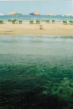 #Umbrellas on the #beach http://sheilablanchette.wordpress.com/?s=walking+beach