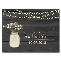 """Woodgrain rustic save the date postcards designed with a mason jar filled with pretty flowers and strings of lights in the background. The color scheme for this rustic outdoor wedding save the date postcard is charcal with tomes of cream and burlap brown. Great for barn weddings, outdoor weddings, and country weddings in spring, summer ad fall- even works well into the winter months. <div style=""""text-align:center;line-height:150%""""> <a ..."""