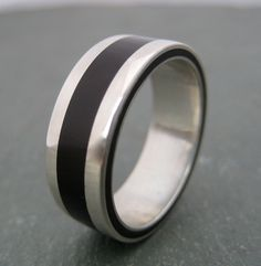 Lados Coyol Wood Ring - ecofriendly wedding ring made with coyol seed ring and recycled sterling silver. $222.00, via Etsy.