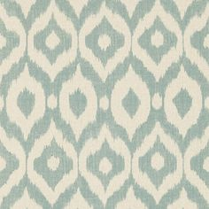 Surin Wallpaper A bold wallpaper with a medium scale non-uniform ogee pattern shown in aqua and beige. The design has been printed to resemble hand-crafted fabric and is inspired by a divine silk warp printed ikat from the Sanderson archive.