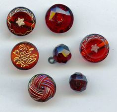 SOLD: 7 Cranberry ruby glass buttons transparent antique buttons