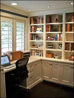 built in desk & shelves in front of a window