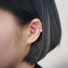 Red rose tattoo on the ear.
