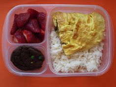 My lunch: taco omelet with rice, strawberries  and a chocolate cookie