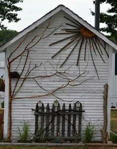 Back of a shed/garage, decorated with things found in nature.