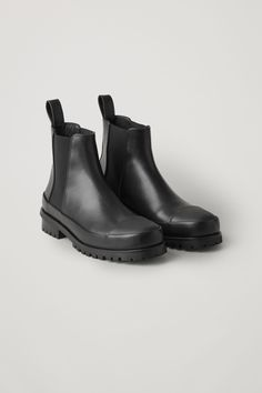 Reworked with chunky rubber soles, these Chelsea boots are a classic pull-on style made from leather with a matte finish. A round toe design, they have elasticated sides, toe caps and they are completed with a leather puller at the back. Black Chelsea Boots, Black Boots, Mens Shoes Boots, Shoe Boots, Mens Leather Accessories, Cartoon Outfits, Chunky Boots, Mens Essentials, Cow Leather