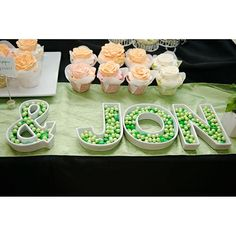 the couple used candy dish letters filled with sweets to spell out their names photo