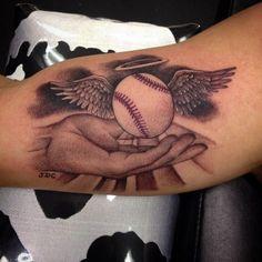 mind-blowing-3d-cross-badeball-with-angel-wings-tattoo-on-bicep.jpg (636×636)