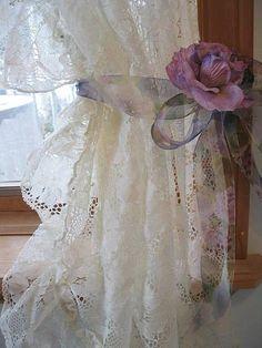 Lavender rose, lace curtain.