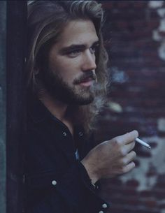 not the cigarette. but cool hair and beard!