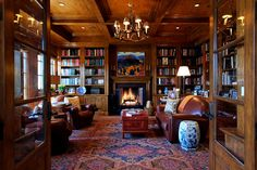 Beautiful warm wood, leather, rug, seating arrangement, lighting and, of course, the fireplace flanked by bookcases