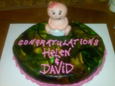 Baby Shower Cake for my brother & sister-in-law. The cake was strawberry (pink) & I covered it in hand painted, camo fondant. The baby is 100% edible, made of rice treat & fondant.