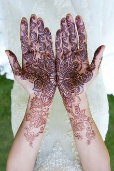 Maybe Western style henna on the inside of your hands, baby? How cool would it look if it was in the shape of redwood trees rings to match our location/style?!