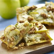 Apple Onion Pizza: Topped with creamy Brie cheese, savory onions, tart apples, blue cheese and chopped walnuts.