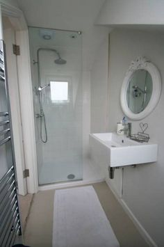 Shower fitted into bathroom with bath as well