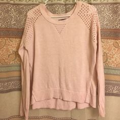 Pink American eagle sweater So cute with the holes on the shoulder! Sadly selling because it is now too small on me. Size medium American Eagle Outfitters Sweaters