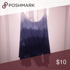 Tie dye ombré tank Never worn but somehow the strap disconnected from the seam on the racerback part, can easily be sewed a few stitches or glued, right now I just have it safety pinned! Size large but I'm a small and still fits when I've tried it on! Should fit all sizes imo very stretchy and versatile Forever 21 Tops Tank Tops
