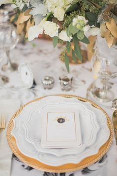 Silver and gold place setting | Bellamint Photography | http://burnettsboards.com/2014/01/royalty-themed-wedding/