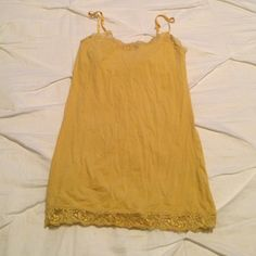 Yellow Lace Tank Top Adjustable straps. Lace on bottom and top of tank Aeropostale Tops Tank Tops