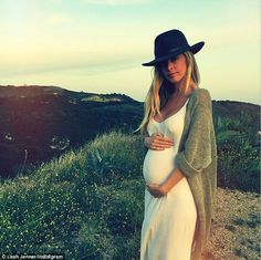 Beautiful: Leah Jenner shared a snap of her growing baby belly wearing a simple white dress at sunset