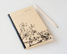 Unique notebook with handmade embroidery and hand-stitched binding. Convenient size to carry around everywhere.