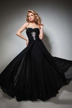 """Start out searching for your perfect long maxi strapless black prom dress by flipping through magazines and online to see what kind of dress you are most attracted to. Then hit the stores with an idea in mind of what you are looking for. Try on as many dresses as you can; your idea of the """"perfect dress"""" may not be as well suited for you as another style. Don't limit yourself."""