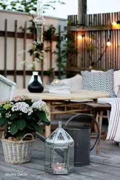 Terraza con muebles de estilo rústico de Styles Decor