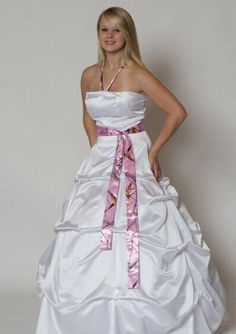 i love this wedding dress becauses it has camoflouage on it and i want camo on my wedding dress when i get married one day !!!