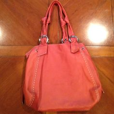 Large cute burnt orange purse Holds so much, really good travel bag! In great condition, normally wear in bottom of bag and a couple scratches in the leather toward the bottom as pictured! Francesco Biasia Bags