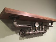 30 shelf made from Reclaimed Wood and Industrial Pipe ½ black industrial pipe and fittings. Your choice of standard black cast iron pipe fittings or hand painted oil rubbed bronze fittings. Stained to the color of your choice, please see palette of available colors. Please note: reclaimed wood comes in all shapes, sizes and will absorb stain differently. No two pieces will ever look exactly the same. Made to order. Please contact me with any questions, special size requests or special…