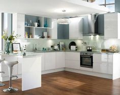 Gloss White Integrated Handle - A gloss white door with an integrated linear pull handle. Combine glass effect square edged worktop with this range to complement its modern look. Add extra tall wall units and bespoke shelving to continue the contemporary theme.
