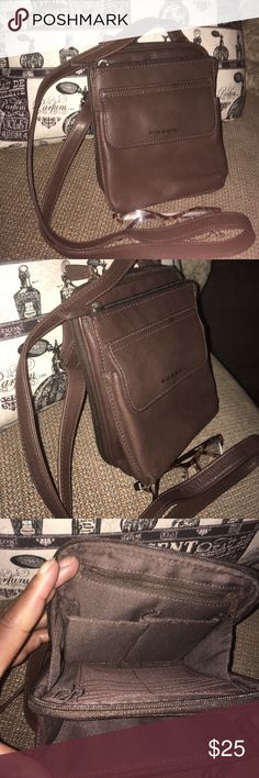 Fossil crossbody brown leather carryall Brown pebbled leather crossbody in mint like new shape. Has lots of pockets and. Compartments. Long adjustable strap. Fossil Bags Crossbody Bags