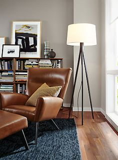 A Room & Board favorite, Boden's dramatic angles, high back and sculptural wood base make it a bold accent chair. The distinctive design features a roomy, comfortable seat that offers a perfect place to stretch out and lounge, especially when paired with an ottoman.