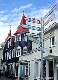 Akureyri town street with multidirectional sign - #Iceland