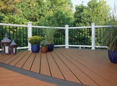 Trex Enhance high performance composite decking in Beach Dune brown and Clam Shell grey Composite Decking, Trex Decking, Decking Ideas, Balcony Flooring, Deck Colors, Concrete Porch, Deck Pictures, New Deck, Deck Railings