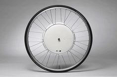 """The """"FlyKly Smart Wheel"""" is an concept that turns mountain bike into an electric bicycle! To create motorized bicycle you equip your bike with an electric motor fully embedded in a single wheel, but also. Bicycle Pedals, Bicycle Wheel, Electric Bicycle Kit, Tricycle, Borne De Recharge, Design Industrial, Old Bikes, 3d Models, Cafe Racer"""