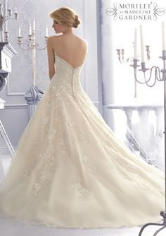 2671 Bridal Gowns / Dresses 2671 Crystal Beaded Embroidery Combined with Lenice Lace Appliques on a Tulle Wedding Gown