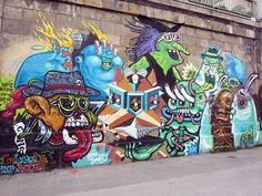"""The creations of German street artists The Weird Collective performed during their """"Weird Travels"""" through Germany, Austria, Netherlands, Luxembourg, Lithuania and Russia. Some colorful pieces of street art full of characters crazier than others, created by DXTR, Vidam, Look, QBRK, Nerd, Cone, Fr. Isa, Rookie, Nychos, Herr von Bias, Sumo, Oren and Spike."""