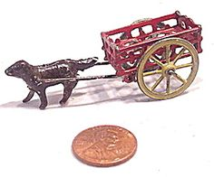 Early 1900s Metal Dog Pulling Cart Penny Toy