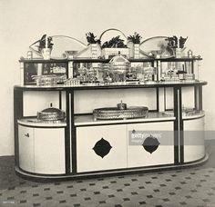 Credenza and dinner service in the exhibition of the Wiener Werkstaette named 'The well laid table'. Neustiftgasse 32-34. In Deutsche Kunst und Dekoration, volume XIX, 1907. page 476.