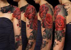 Red roses on black blur tattoo