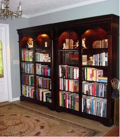 """2 Library bookcases = 92"""" wide, 72"""" high, 15"""" deep. Recessed lighting in the top. http://www.hayneedle.com/product/martinfurniturebeaumontopenbookcase46in.cfm"""