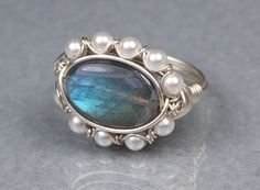 Labradorite is one of my favorite stones. Wish to hell I could figure out how to polish one decently.