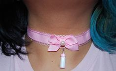 ***this is a made to order listing, items will take between 1-3 days so please keep in mind when purchasing***  a pink ribbon with a sheer pink scallop border and a pink bow with a cute pearl on top the bow. Accented with a little baby bottle hanging from the choker. Ribbon strip measures at 12.5 inches with 2 2 chains attached with a lobster clasp.  Handmade with love.