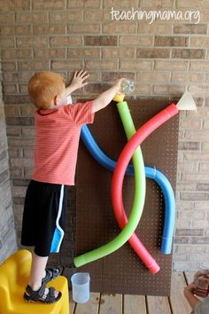 Pool Noodle Water Wall - What a fun summer AND winter activity! Outside with water in the summer, inside with marbles in the winter! (Please use caution with children that are too young to not know to not put the marbles in their mouths.) OR, inside in the bathtub in the winter, to keep the water fun going!! :-)