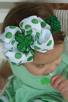"St. Patrick's Day Bow --- Lucky Little Girl --- 5"" double bow with glitter Shamrock center on Etsy, $7.95"