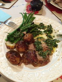 Roast lamb with salsa verde made with mint basil & parsley
