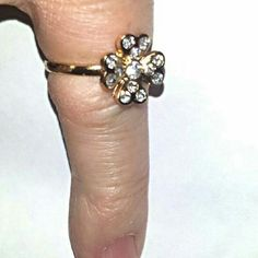 Gold Lucky Clover Ring This ring is made of gold alloy metal & rhinestones & can be adjusted by gently pulling or squeezing the sides. It has 3 stones on each leaf & another in the middle for a total of 13. It really catches the light!  4/1 Jewelry Rings