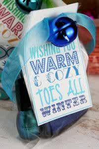 """A nice gift idea for a reasonable price.  I'm going to make my tag look like a chalk board message and add either cream or red cozy socks with matching nail polish.  You could also delete the """"toes"""" in the script and have it just say """"warm and cozy winter"""".  Add hot chocolate packs."""